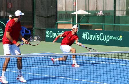 melzer: KYIV, UKRAINE - JULY 16, 2016: Players of Austria in action during BNP Paribas Davis Cup EuropeAfrica Zone Group I pair game against Ukraine at Campa Bucha Tennis Club in Kyiv, Ukraine