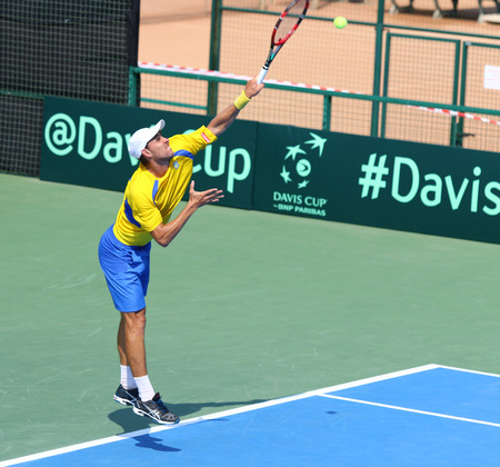 paribas: KYIV, UKRAINE - JULY 16, 2016: Artem SMIRNOV of Ukraine serves during BNP Paribas Davis Cup pair game against Austria at Campa Bucha Tennis Club in Kyiv, Ukraine Editorial