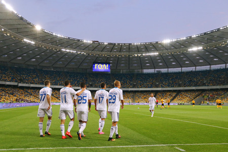 react: KYIV, UKRAINE - JULY 23, 2016: FC Dynamo Kyiv players react after scored a goal during Ukrainian Premier League game against FC Oleksandria at NSC Olympic stadium in Kyiv