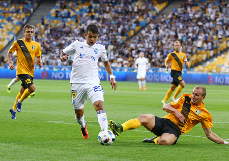 premier: KYIV, UKRAINE - JULY 23, 2016: Derlis Gonzalez of Dynamo Kyiv (L) fights for a ball with Sergii Basov of FC Oleksandria during their Ukrainian Premier League game at NSC Olympic stadium in Kyiv