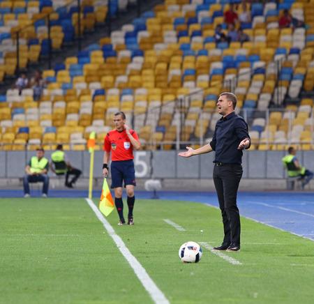 striker: KYIV, UKRAINE - JULY 23, 2016: Head coach of FC Dynamo Kyiv Sergiy Rebrov reacts during Ukrainian Premier League game against FC Oleksandria at NSC Olympic stadium in Kyiv