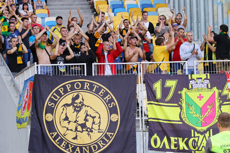 olimpiysky: KYIV, UKRAINE - JULY 23, 2016: FC Oleksandria supporters show their support during Ukrainian Premier League game against FC Dynamo Kyiv at NSC Olympic stadium in Kyiv Editorial