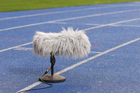 professional sport: Big and furry professional sport microphone near the football field