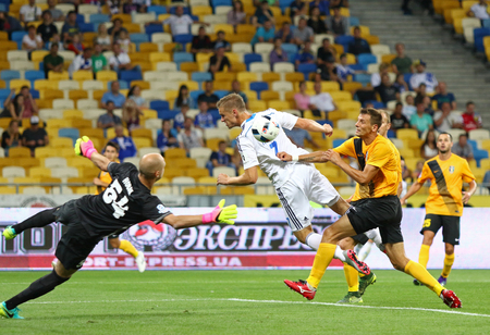 KYIV, UKRAINE - JULY 23, 2016: Oleksandr Gladkyy of FC Dynamo Kyiv (in White) fights for a ball with FC Oleksandria players during Ukrainian Premier League game at NSC Olympic stadium in Kyiv Editorial