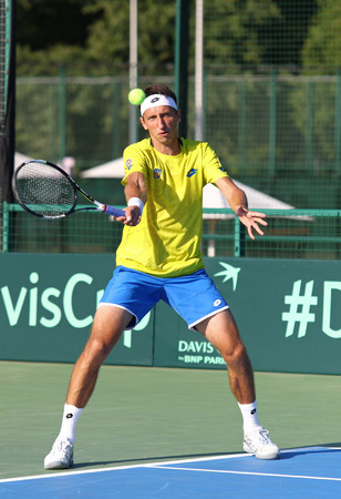 paribas: KYIV, UKRAINE - JULY 15, 2016: Sergiy STAKHOVSKY of Ukraine in action during BNP Paribas Davis Cup EuropeAfrica Zone Group I game against Gerald MELZER of Austria at Campa Bucha Tennis Club in Kyiv