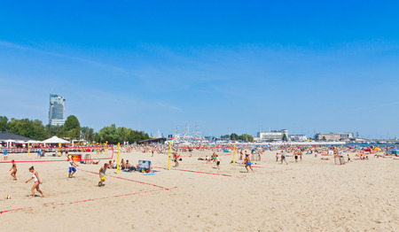 baltic people: GDYNIA, POLAND - AUGUST 2, 2015: People play volleyball on Municipal beach in Gdynia, Baltic sea, Poland