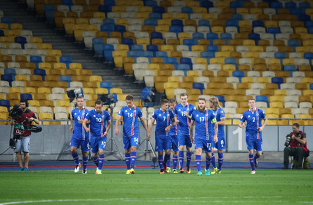 scored: KYIV, UKRAINE - SEPTEMBER 5, 2016: Island players celebrate after scored a goal during FIFA World Cup 2018 qualifying game against Ukraine at NSC Olympic stadium in Kyiv, Ukraine