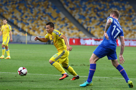 KYIV, UKRAINE - SEPTEMBER 5, 2016: Yevhen Konoplyanka of Ukraine (L) controls a ball during FIFA World Cup 2018 qualifying game against Iceland at NSC Olympic stadium in Kyiv, Ukraine
