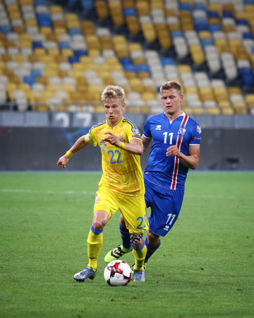 KYIV, UKRAINE - SEPTEMBER 5, 2016: Olexandr Zinchenko of Ukraine (L) fights for a ball with Alfred Finnbogason of Iceland during their FIFA World Cup 2018 qualifying game at NSC Olympic stadium