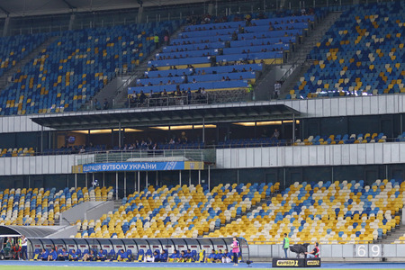 KYIV, UKRAINE - SEPTEMBER 5, 2016: Empty tribunes of NSC Olympic stadium during FIFA World Cup 2018 qualifying game between Ukraine and Iceland. FIFA punished Ukraine with a match without spectators Editorial