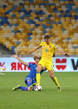 KYIV, UKRAINE - SEPTEMBER 5, 2016: Serhiy Sydorchuk of Ukraine (in Yellow) fights for a ball with Birkir Bjarnason of Iceland during their FIFA World Cup 2018 qualifying game at NSC Olympic stadium