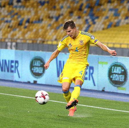 eduard: KYIV; UKRAINE - SEPTEMBER 5; 2016: Eduard Sobol of Ukraine kicks a ball during FIFA World Cup 2018 qualifying game against Iceland at NSC Olympic stadium in Kyiv; Ukraine