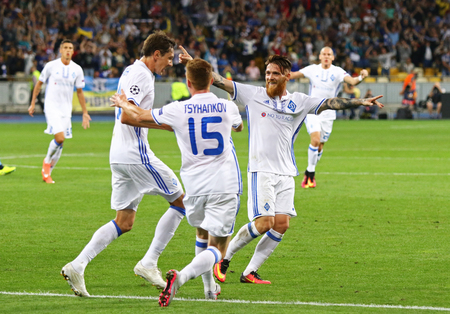 react: KYIV, UKRAINE - SEPTEMBER 13, 2016: FC Dynamo Kyiv players react after score a goal during UEFA Champions League game against SSC Napoli at NSC Olympic stadium in Kyiv, Ukraine