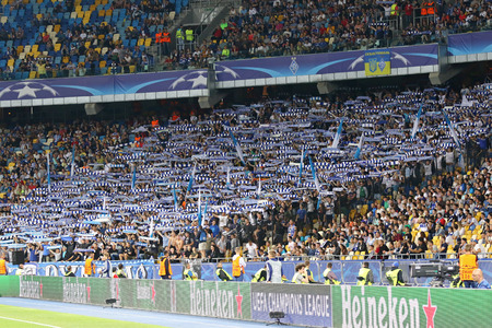 ultras: KYIV, UKRAINE - SEPTEMBER 13, 2016: FC Dynamo Kyiv ultra supporters (ultras) perform during UEFA Champions League game against SSC Napoli at NSC Olympic stadium in Kyiv, Ukraine