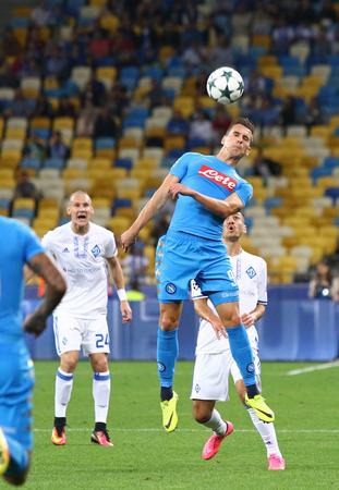 KYIV, UKRAINE - SEPTEMBER 13, 2016: Arkadiusz Milik of SSC Napoli kicks the ball during UEFA Champions League game against FC Dynamo Kyiv at NSC Olympic stadium in Kyiv, Ukraine Editorial