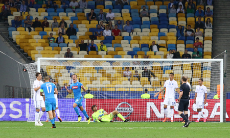 scored: KYIV, UKRAINE - SEPTEMBER 13, 2016: Arkadiusz Milik of SSC Napoli reacts after scored a goal during UEFA Champions League game against FC Dynamo Kyiv at NSC Olympic stadium in Kyiv