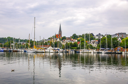 kiel fjord: FLENSBURG, GERMANY - JULY 29, 2012: Vew of harbour in Flensburg, the independent town in the North of German state of Schleswig-Holstein. After Kiel and Lubeck it is the 3rd largest town in region