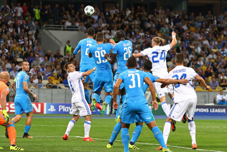 KYIV, UKRAINE - SEPTEMBER 13, 2016: FC Dynamo Kyiv (in White) and SSC Napoli (in Blue) players fight for a ball during their UEFA Champions League game at NSC Olympic stadium in Kyiv, Ukraine
