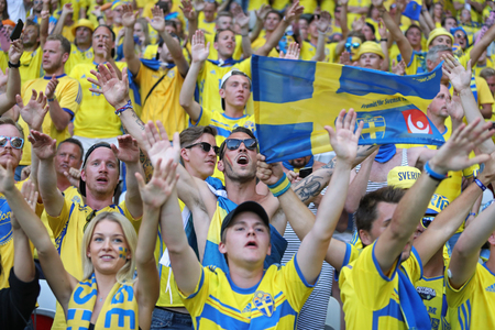 ultras: NICE, FRANCE - JUNE 22, 2016: Swedish fans show their support during the UEFA EURO 2016 game Sweden v Belgium at Allianz Riviera Stade de Nice, Nice, France