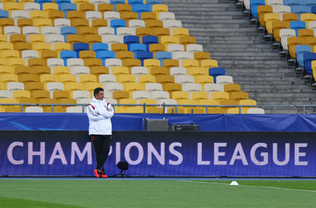 vitoria: KYIV, UKRAINE - OCTOBER 18, 2016: SL Benfica manager Rui Vitoria walks on the pitch during training session before UEFA Champions League game against FC Dynamo Kyiv at NSC Olimpiyskyi stadium in Kyiv Editorial