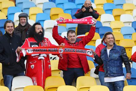 ultras: KYIV, UKRAINE - OCTOBER 18, 2016: SL Benfica supporters show their support during training session at NSC Olimpiyskyi stadium before UEFA Champions League game against FC Dynamo Kyiv