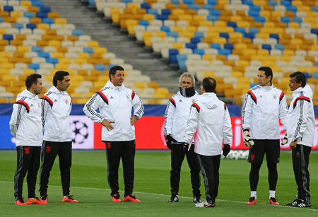 KYIV, UKRAINE - OCTOBER 18, 2016: SL Benfica manager Rui Vitoria (3rd from L) and his assistants walk on the pitch during training session before UEFA Champions League game against FC Dynamo Kyiv Editorial
