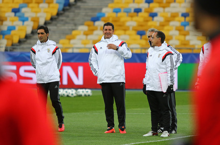 KYIV, UKRAINE - OCTOBER 18, 2016: SL Benfica manager Rui Vitoria (2nd from L) and his assistants walk on the pitch during training session before UEFA Champions League game against FC Dynamo Kyiv