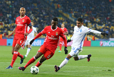 KYIV, UKRAINE - OCTOBER 19, 2016: Derlis Gonzalez of Dynamo Kyiv (R) fights for a ball with Nelson Semedo of Benfica during their UEFA Champions League game at NSC Olimpiyskyi stadium in Kyiv, Ukraine