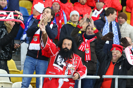 KYIV, UKRAINE - OCTOBER 19, 2016: SL Benfica supporters show their support during UEFA Champions League game against FC Dynamo Kyiv at NSC Olimpiyskyi stadium in Kyiv, Ukraine