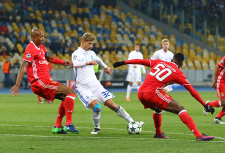 KYIV, UKRAINE - OCTOBER 19, 2016: Valeriy Fedorchuk of Dynamo Kyiv (C) fights for a ball with Luisao (L) and Nelson Semedo of Benfica during their UEFA Champions League game at NSC Olimpiyskyi stadium