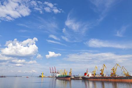 Lifting cargo cranes and ship in sea port of Odessa, Black Sea, Ukraine