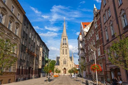 KATOWICE, POLAND - JULY 28, 2015: St. Marys Street (Polish: Ulica Mariacka) and St. Marys Church (Kosciol Mariacki) in Katowice