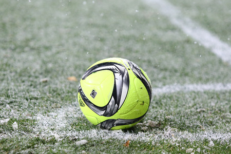 luhansk: KYIV, UKRAINE - OCTOBER 26, 2016: Yellow football ball on a snowy grass during Cup of Ukraine Round of 16 game FC Dynamo Kyiv v Zorya Luhansk at NSC Olimpiyskyi stadium in Kyiv, Ukraine