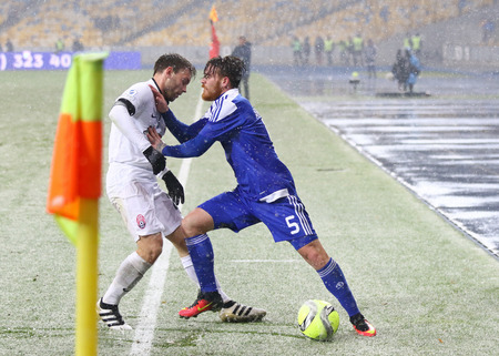 luhansk: KYIV, UKRAINE - OCTOBER 26, 2016: Antunes of FC Dynamo Kyiv (R) fights for a ball with Oleksandr Karavayev of Zorya Luhansk during their Cup of Ukraine Round of 16 game at NSC Olimpiyskyi stadium