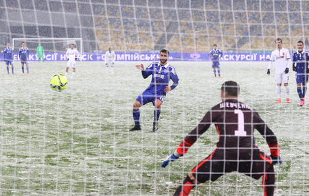 luhansk: KYIV, UKRAINE - OCTOBER 26, 2016: Junior Moraes of FC Dynamo Kyiv (in Blue) scores a penalty during the Cup of Ukraine Round of 16 game against Zorya Luhansk at NSC Olimpiyskyi stadium in Kyiv Editorial