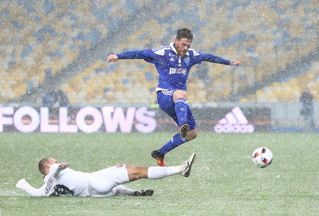 luhansk: KYIV, UKRAINE - OCTOBER 26, 2016: Antunes of FC Dynamo Kyiv (R) fights for a ball with Yevhen Opanasenko of Zorya Luhansk during their Cup of Ukraine Round 16 game at NSC Olimpiyskyi stadium in Kyiv Editorial