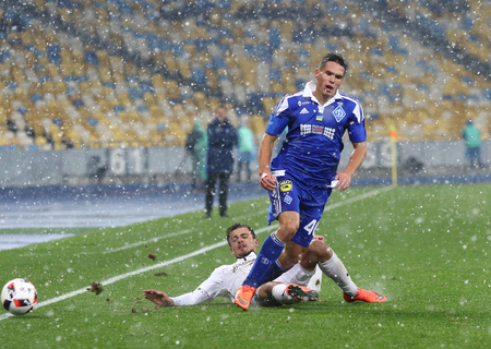 luhansk: KYIV, UKRAINE - OCTOBER 26, 2016: Oleksandr Tymchyk of FC Dynamo Kyiv (R) fights for a ball with Mikhail Sivakov of Zorya Luhansk during their Cup of Ukraine game at NSC Olimpiyskyi stadium in Kyiv Editorial