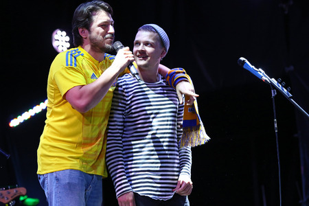 the showman: KYIV, UKRAINE - SEPTEMBER 5, 2016: Showman Serhiy Prytula (L) and singer Yevhen Halych on stage near the NSC Olympic stadium during rock-concert before FIFA World Cup 2018 game Ukraine v Iceland