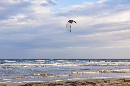 mile: Kitesurfing in a cloudy autumn day. Ladys Mile beach in Limassol, Cyprus