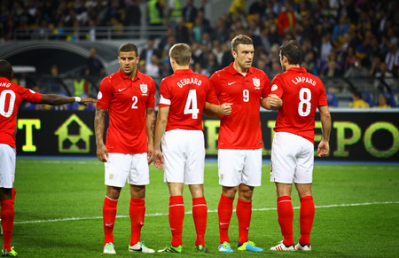 KYIV, UKRAINE - SEPTEMBER 10, 2013: Players of England National football team standing in a wall before free-kick during FIFA World Cup 2014 qualifier game against Ukraine at NSC Olympic stadium