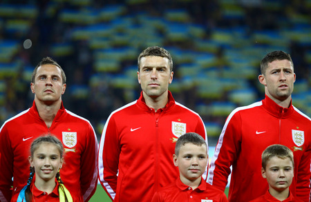 cahill: KYIV, UKRAINE - SEPTEMBER 10, 2013: Players of England National football team listen to national anthems before FIFA World Cup 2014 qualifier game against Ukraine at NSC Olympic stadium in Kyiv Editorial
