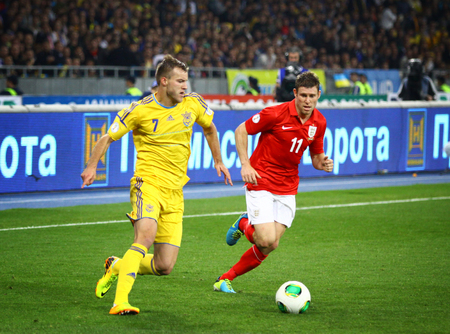 striker: KYIV, UKRAINE - SEPTEMBER 10, 2013: Andriy Yarmolenko of Ukraine (L) fights for a ball with James Milner of England during their FIFA World Cup 2014 qualifier game at NSC Olympic stadium in Kyiv Editorial