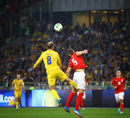 cahill: KYIV, UKRAINE - SEPTEMBER 10, 2013: Roman Zozulya of Ukraine (L) fights for a ball with Gary Cahill of England during their FIFA World Cup 2014 qualifier game at NSC Olympic stadium in Kyiv Editorial