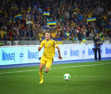 striker: KYIV, UKRAINE - SEPTEMBER 10, 2013: Striker Andriy Yarmolenko of Ukraine controls a ball during FIFA World Cup 2014 qualifier game against England at NSC Olympic stadium in Kyiv Editorial