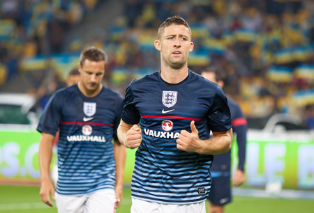 cahill: KYIV, UKRAINE - SEPTEMBER 10, 2013: Gary Cahill of England walks on during training session before FIFA World Cup 2014 qualifier game against Ukraine at NSC Olympic stadium in Kyiv