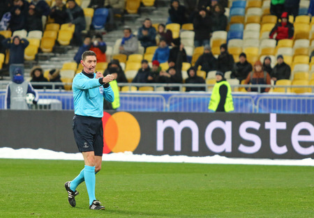 KYIV, UKRAINE - DECEMBER 6, 2016: Referee Craig Thomson whistles the penalty kick during UEFA Champions League game FC Dynamo Kyiv vs Besiktas at NSC Olimpiyskyi stadium in Kyiv, Ukraine