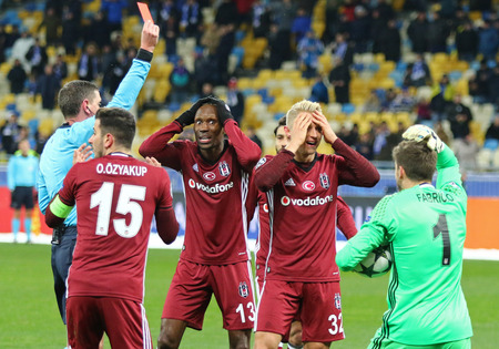 KYIV, UKRAINE - DECEMBER 6, 2016: Besiktas players react after referee Craig Thomson gave the penalty kick during UEFA Champions League game against FC Dynamo Kyiv at NSC Olimpiyskyi stadium in Kyiv