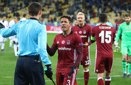 react: KYIV, UKRAINE - DECEMBER 6, 2016: Besiktas players react after referee Craig Thomson gave the penalty kick during UEFA Champions League game against FC Dynamo Kyiv at NSC Olimpiyskyi stadium in Kyiv