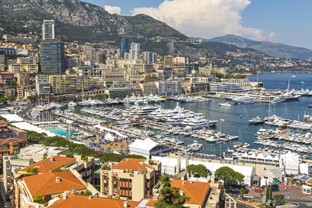 monte carlo: Monte Carlo city skyline panorama. View of luxury yachts and apartments in harbor of Monte Carlo, Monaco, Cote dAzur