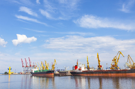Lifting cargo cranes, ship and grain dryer in Sea Port of Odessa, Black Sea, Ukraine. Odessa Marine Trade Port is the largest Ukrainian seaport and one of the largest ports in the Black Sea basin